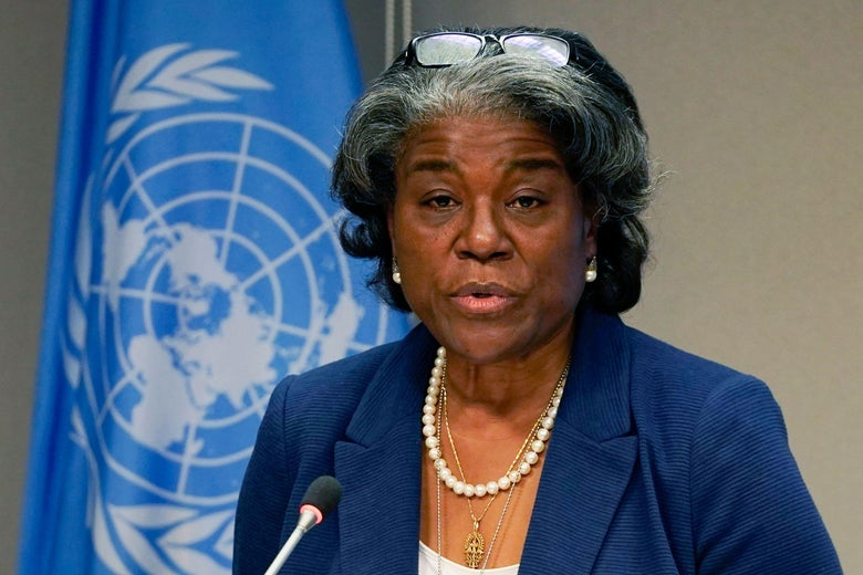 Linda Thomas-Greenfield speaking in front of a UN flag