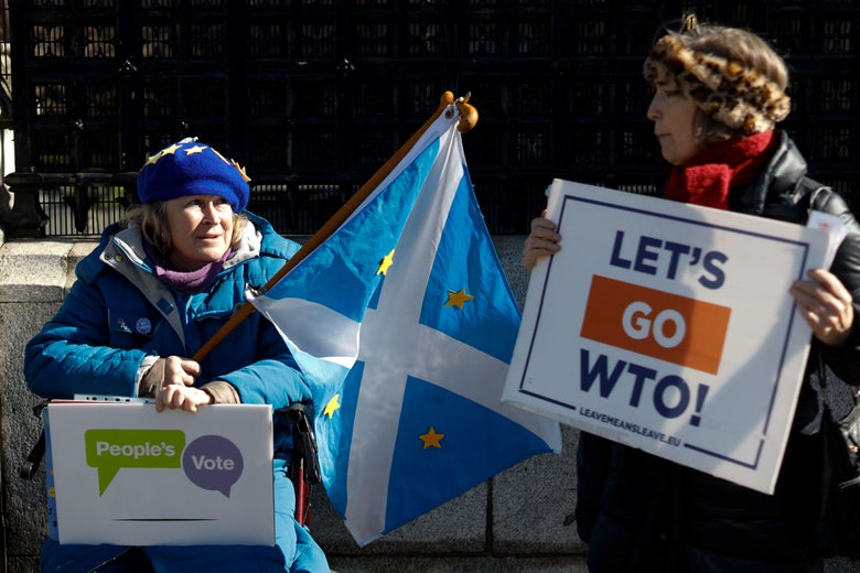 An anti-Brexit and a pro-Brexit activist demonstrate outside of the Houses of Parliament in London on March 14, 2019, before a further Brexit vote.
