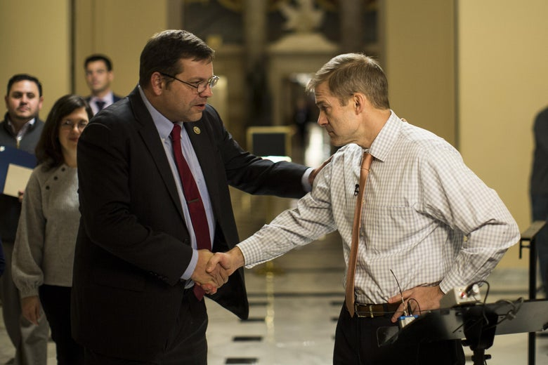 WASHINGTON, DC - DECEMBER 4: (L to R) Rep. Tom Garrett Jr. (R-VA) shakes hands with House Freedom Caucus member Rep. Jim Jordan (R-OH) on his way to the House floor on Capitol Hill, December 4, 2017 in Washington, DC. The House voted to formally send their tax reform bill to a joint conference committee with the Senate, where they will try to merge the two bills. (Drew Angerer/Getty Images)