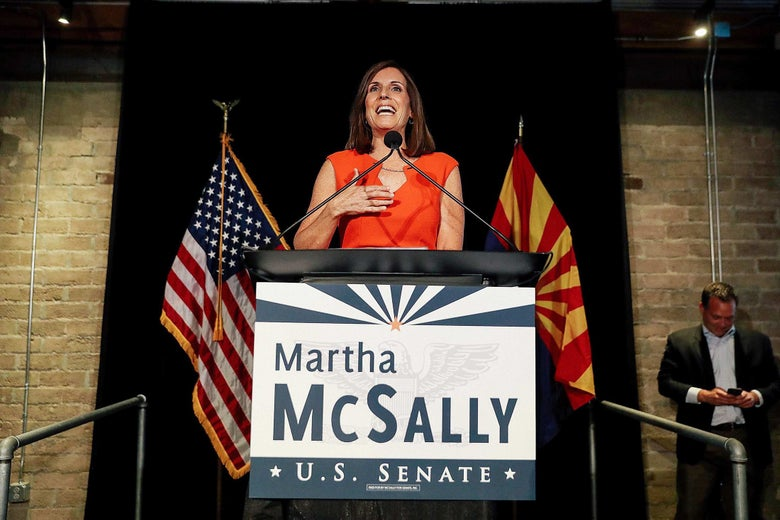 "Martha McSally speaks from behind a podium that says ""Martha McSally U.S. Senate."""