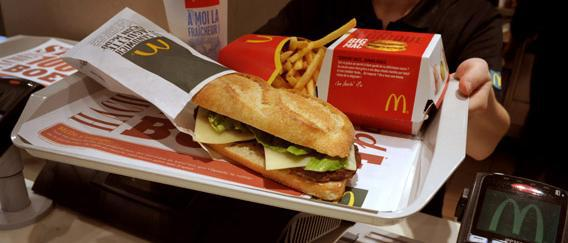 "A worker shows the McBaguette, the French ""baguette"" sold by US fast food giant McDonald's in their French outlets."