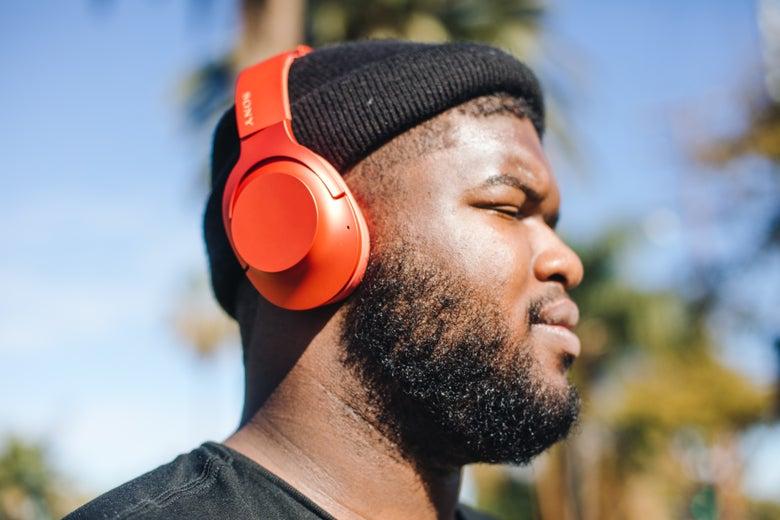 man wearing red Sony headphones