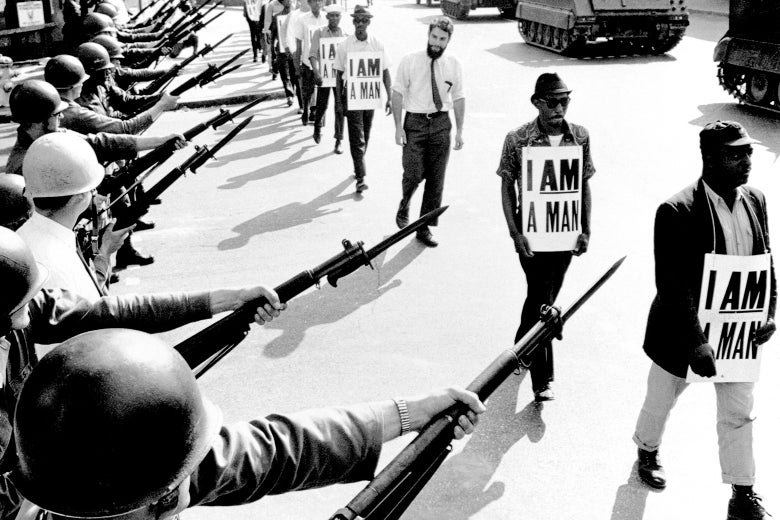 Civil Rights activists are blocked by National Guardsmen brandishing bayonets while trying to stage a protest on Beale Street in Memphis, Tennessee.