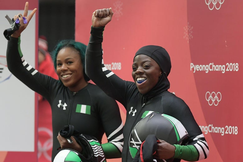 Nigeria's Moriam Seun Adigun (R) and Nigeria's Akuoma Omeoga wave after the women's bobsleigh heat 2 run during the Pyeongchang 2018 Winter Olympic Games, at the Olympic Sliding Centre on February 20, 2018 in Pyeongchang.  / AFP PHOTO / MOHD RASFAN        (Photo credit should read MOHD RASFAN/AFP/Getty Images)