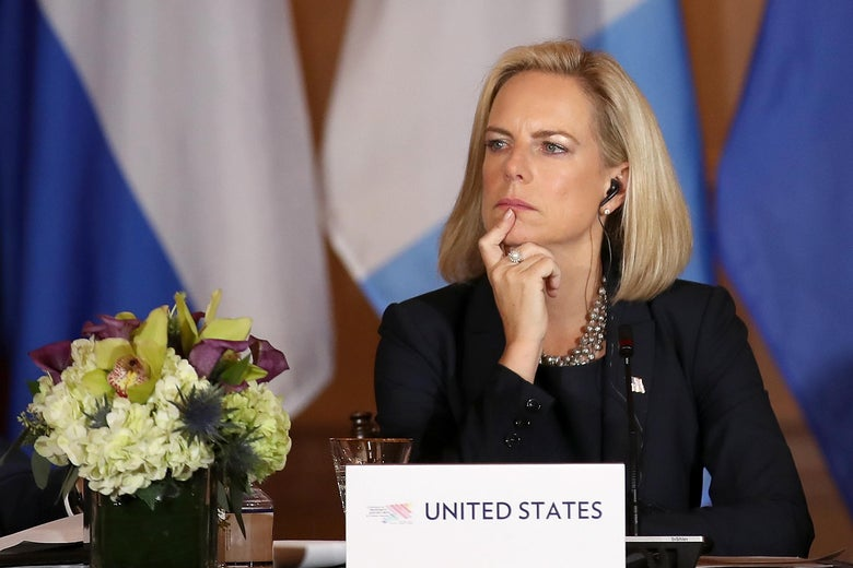Nielsen looks thoughtful as she sits at a table representing the U.S.