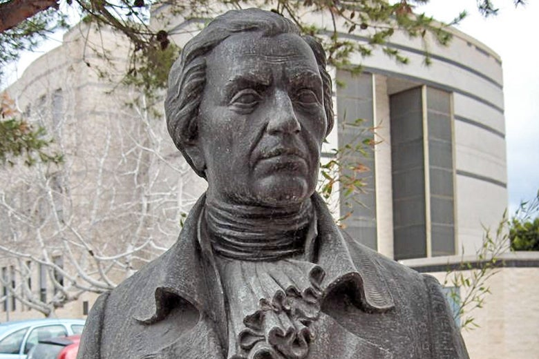 A stone bust of Francisco Javier de Balmis outside a university building