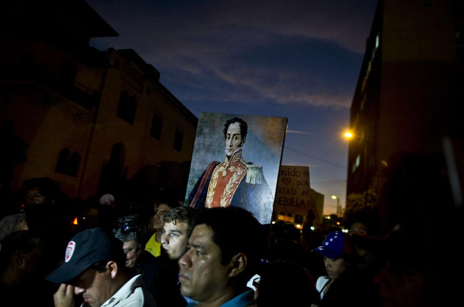 Demonstrators protest against Venezuela's President Nicolas Maduro outside Venezuela's embassy in Lima on February 18, 2014.