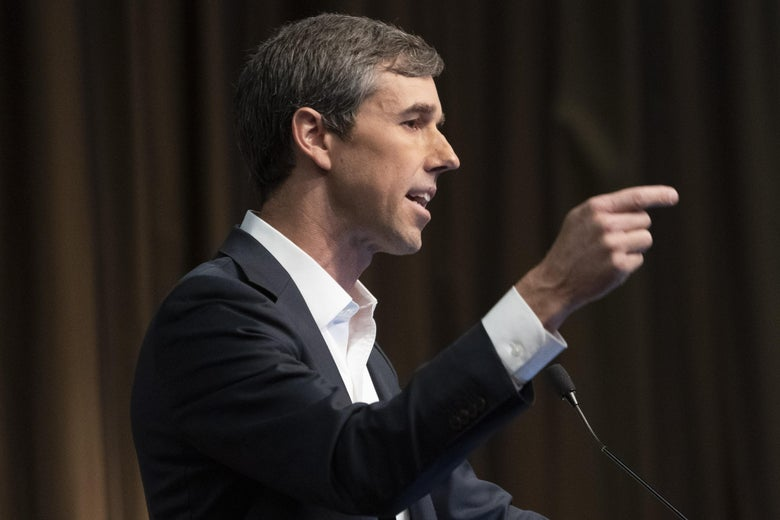 Beto O'Rourke gesticulates while speaking at an event.