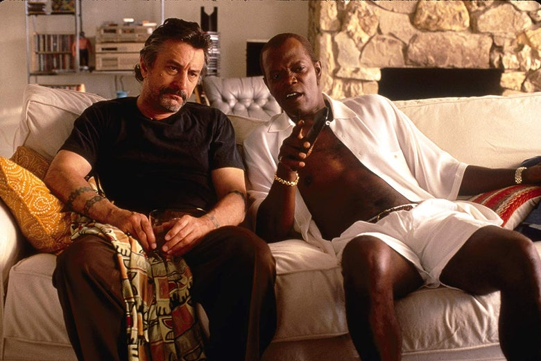 Robert De Niro and Samuel L. Jackson lounge on a couch.