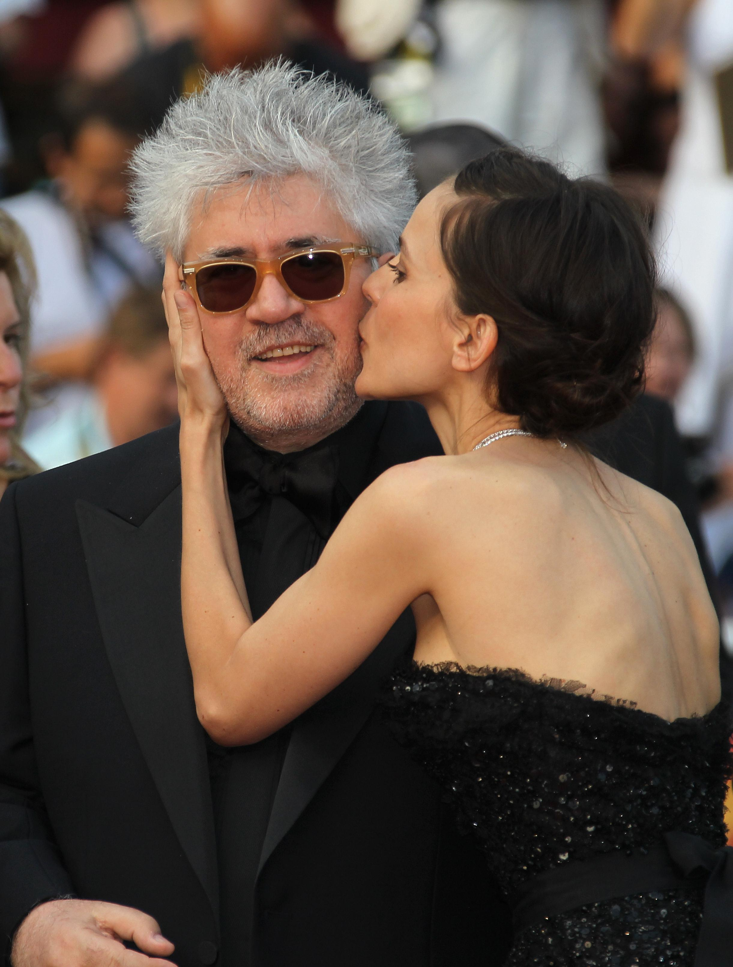 Elena Anaya kisses Pedro Almodovar before a screening of The Skin I Live In at Cannes in May.