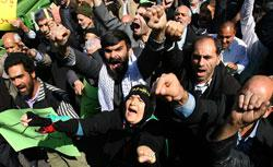 Iranians shout slogans during a protest in Tehran. Click to expand image.