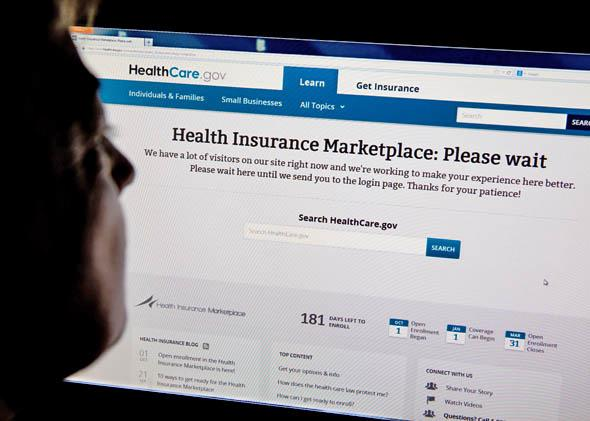 A woman looks at the Healthcare.gov insurance exchange website.