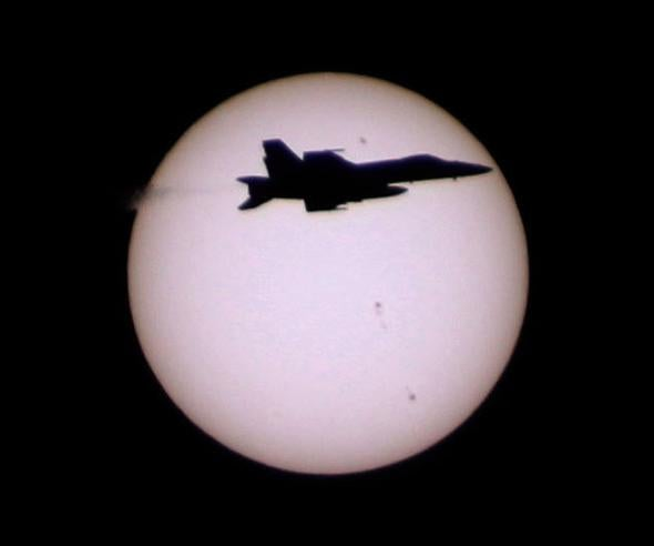 f18 in front of the Sun