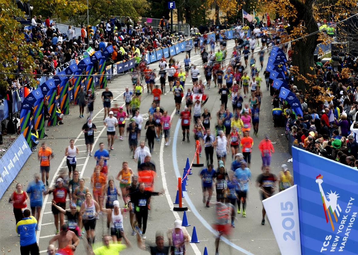 Runners run across the finish line at the 2015 New York City Marathon in New York's Central Park, November 1, 2015.