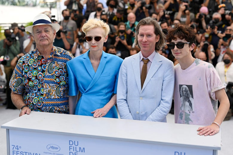 """U.S. actor Bill Murray, British actress Tilda Swinton, U.S. director Wes Anderson and French-U.S. actor Timothee Chalamet pose during a photo call for the film """"The French Dispatch"""" at the 74th edition of the Cannes Film Festival in Cannes, southern France."""
