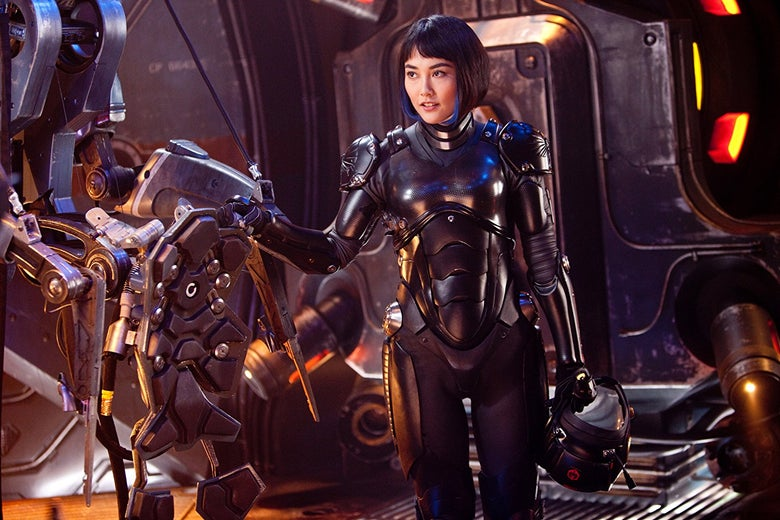 Rinko Kikuchi as Mako Mori in Pacific Rim. Mako wears a fitted, futuristic black suit in anticipation of boarding her jaeger.