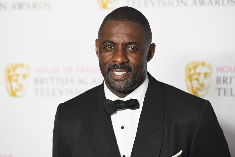 Idris Elba wearing a tux on the BAFTAs red carpet.
