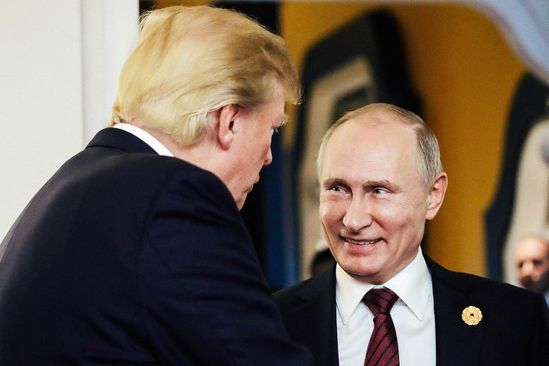 U.S. President Donald Trump and Russian President Vladimir Putin talk after a meeting on the closing day of the 25th APEC Summit.