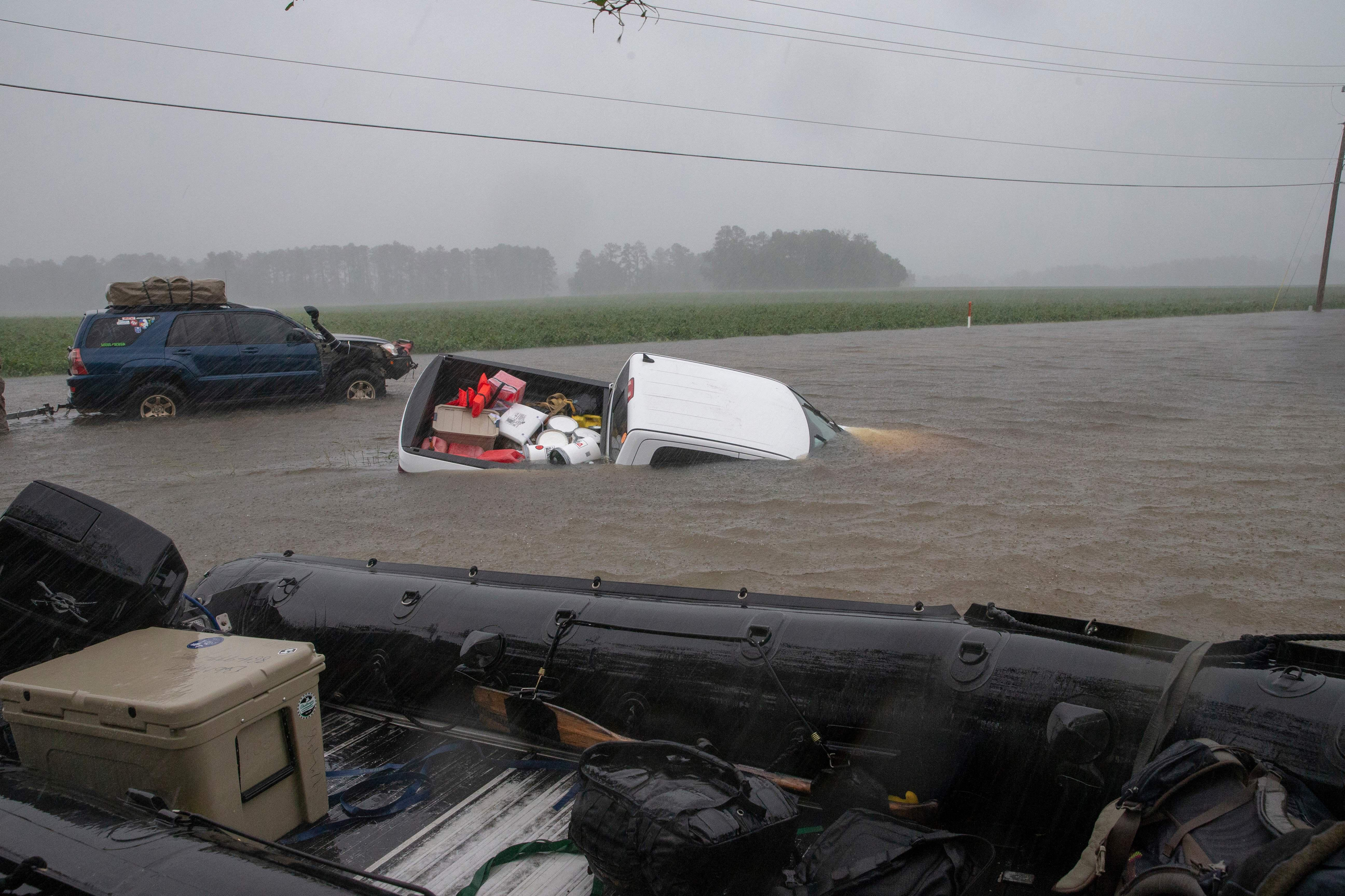 A pickup truck is seen submerged in floodwater in Lumberton, North Carolina, on September 15, 2018 in the wake of Hurricane Florence.