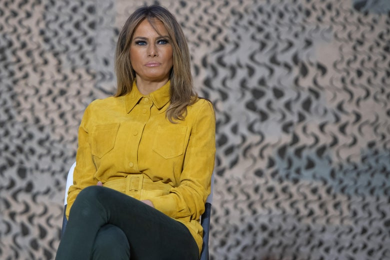 First Lady Melania Trump sits onstage during an unannounced trip to Al Asad Air Base in Iraq on December 26, 2018.