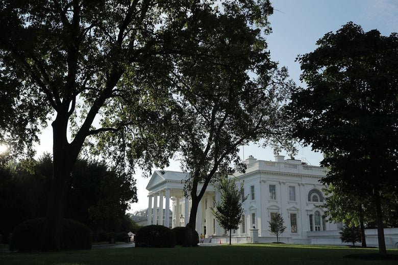 An exterior shot of the White House in early morning light.
