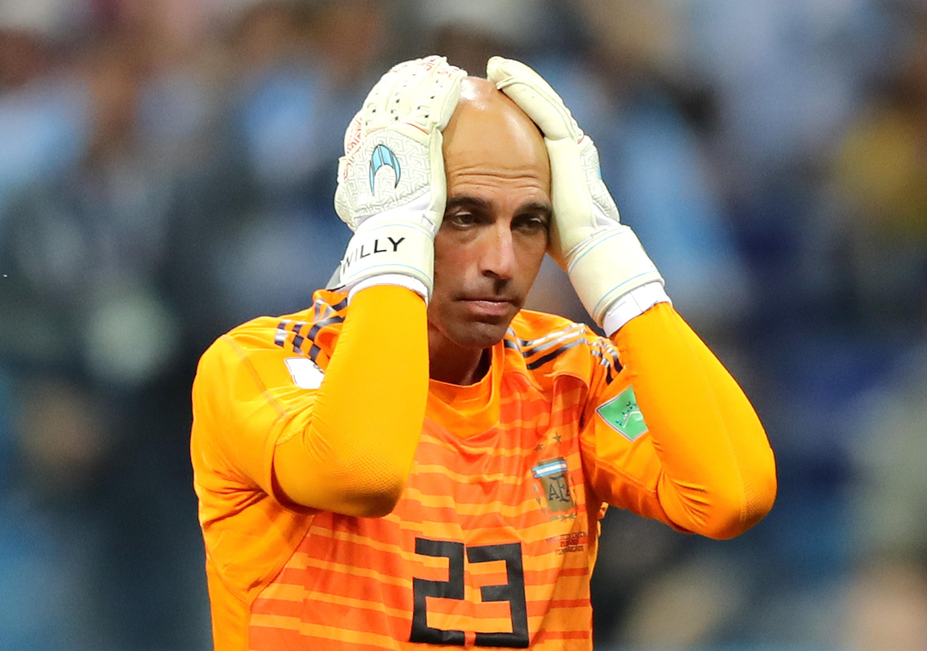 NIZHNY NOVGOROD, RUSSIA - JUNE 21:  Wilfredo Caballero of Argentina holds his head in his hands as he stands dejected after his mistake leads to a Croatia goal scored by Ante Rebic (not pictured) during the 2018 FIFA World Cup Russia group D match between Argentina and Croatia at Nizhny Novgorod Stadium on June 21, 2018 in Nizhny Novgorod, Russia.  (Photo by Elsa/Getty Images)