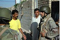 Capt. Juwad questions a witness after an RPG attack in Fallujah, September 2005.          Click image to expand.