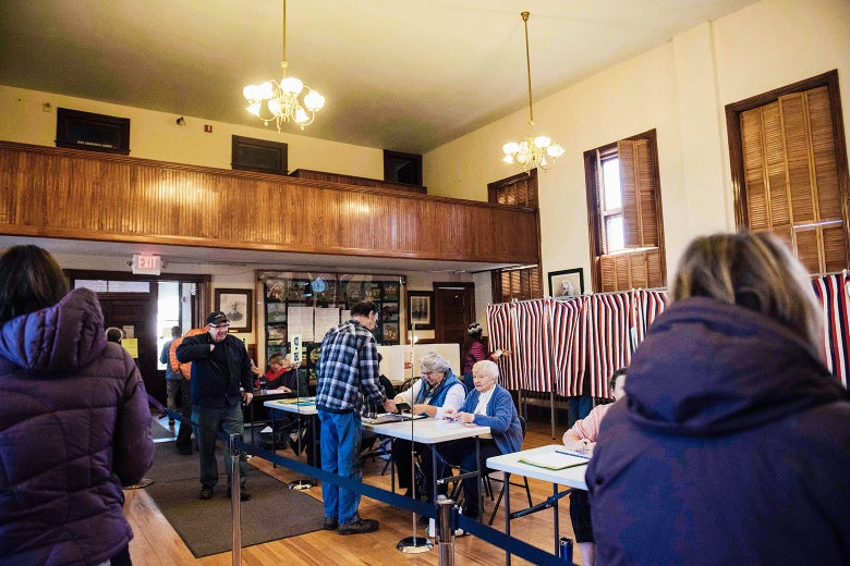 Voters cast their ballots in the presidential election at the Sutton town hall on Nov. 8, 2016, in New Hampshire.