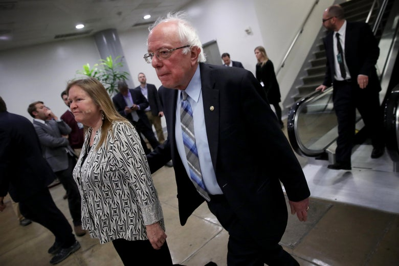 WASHINGTON, DC - JANUARY 31: Sen. Bernie Sanders (I-VT) walks with his wife Jane after leaving the Senate floor for a vote on legislation advancing Senate Majority Leader Mitch McConnell's plan voicing opposition to U.S. President Donald Trump's intention of withdrawing U.S. troops from Afghanistan and Syria on January 31, 2019 in Washington, DC. The Senate voted in overwhelmingly bipartisan fashion in favor of the legislation, rebuking President Trump's policy. (Photo by Win McNamee/Getty Images)