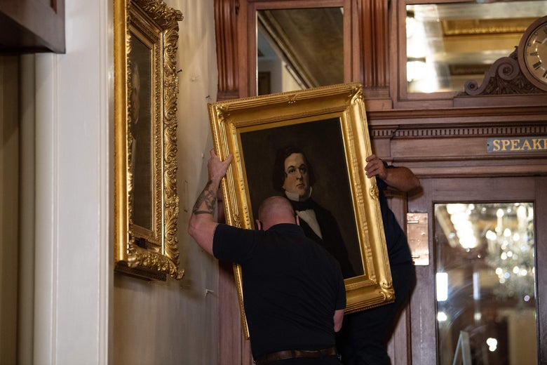 Workers remove a painting of former confederate House Speaker Howell Cobb of Georgia, from the Speakers lobby in the Capitol building.