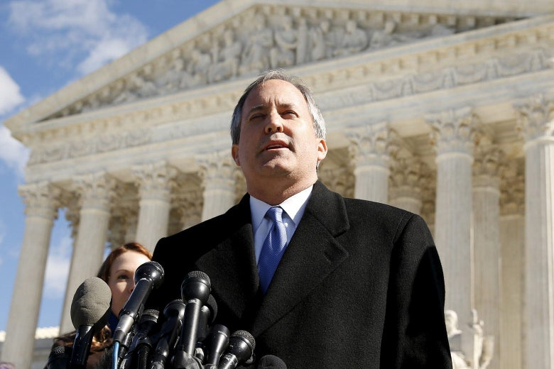 Paxton stands at a cluster of mics on the steps of the U.S. Supreme Court.