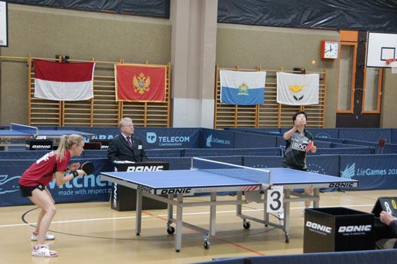 Luxembourg's table tennis star Ni Xianlian serves against teammate Sarah de Nutte.