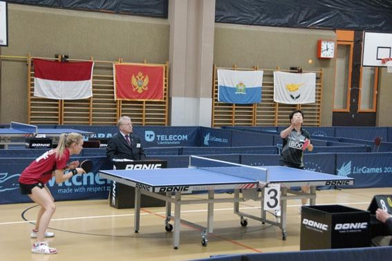 Luxembourg's table tennis star Ni Xianlian serves against teammate Sarah de Nutte.