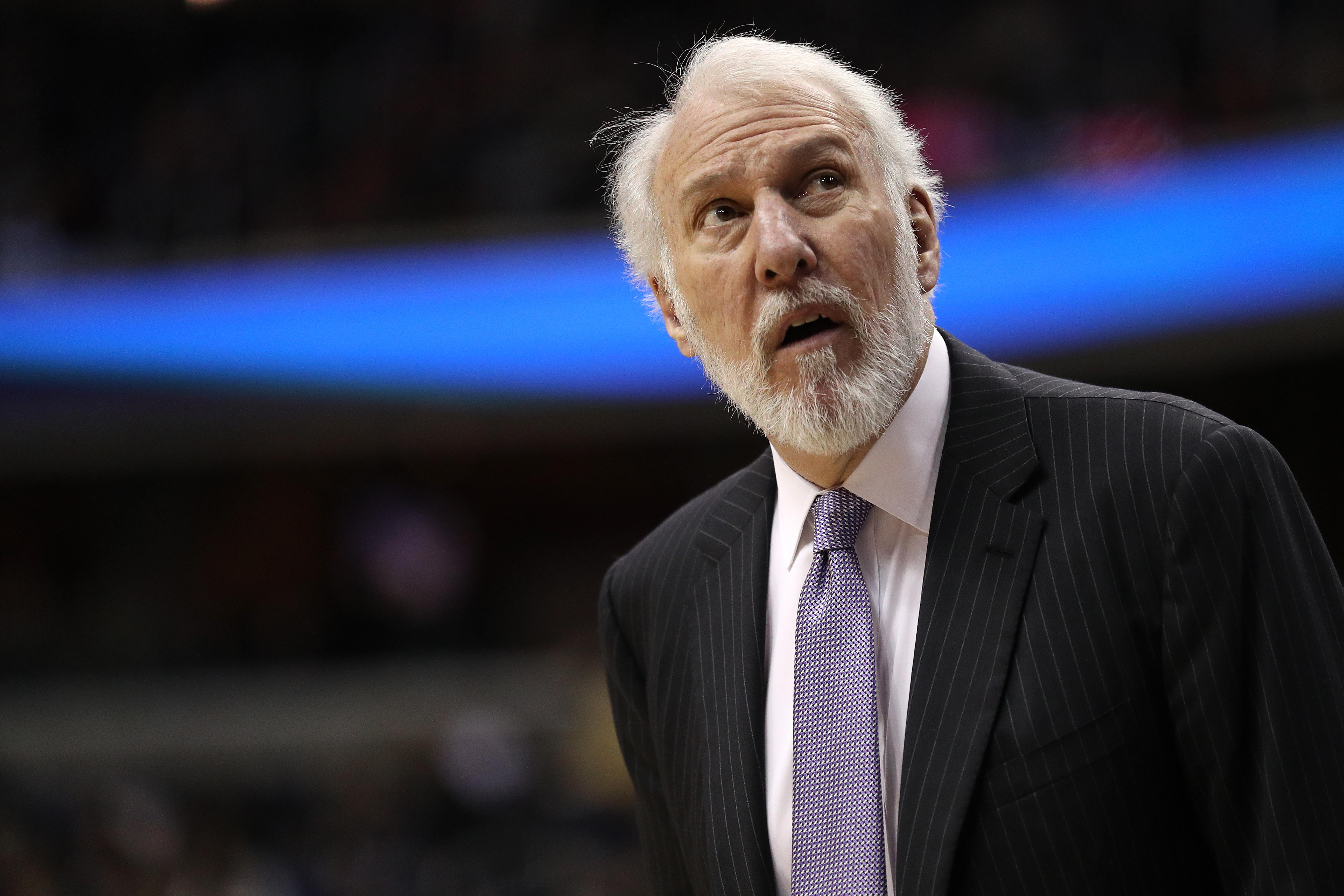 WASHINGTON, DC - MARCH 27: Head coach Gregg Popovich of the San Antonio Spurs looks on against the Washington Wizards during the first half at Capital One Arena on March 27, 2018 in Washington, DC. NOTE TO USER: User expressly acknowledges and agrees that, by downloading and or using this photograph, User is consenting to the terms and conditions of the Getty Images License Agreement. (Photo by Patrick Smith/Getty Images)