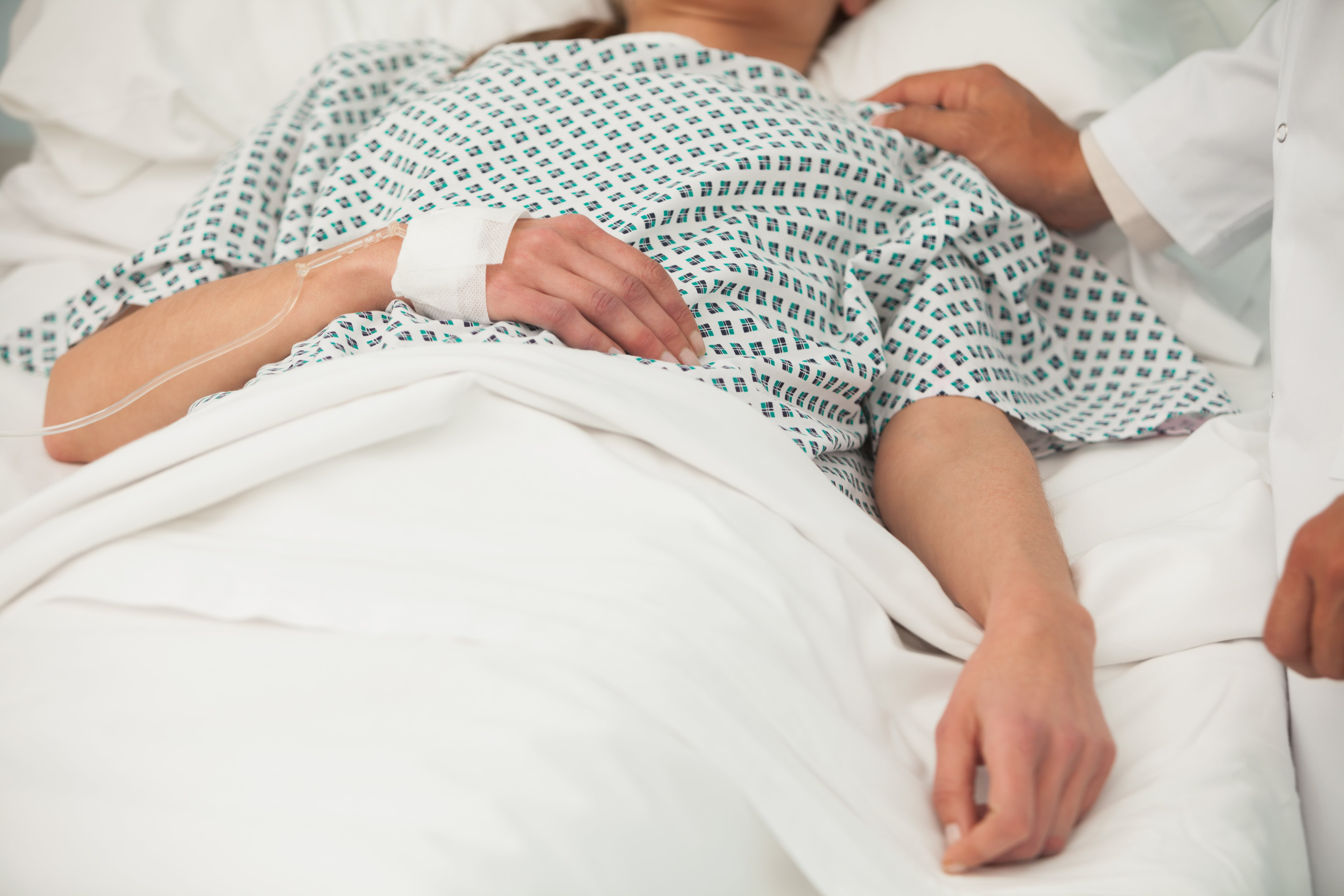 Woman lying in a hospital bed