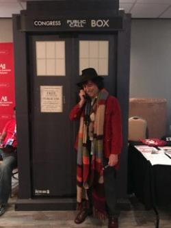 The Fourth Doctor of Doctor Who uses the TARDIS to call Congress and support net neutrality.