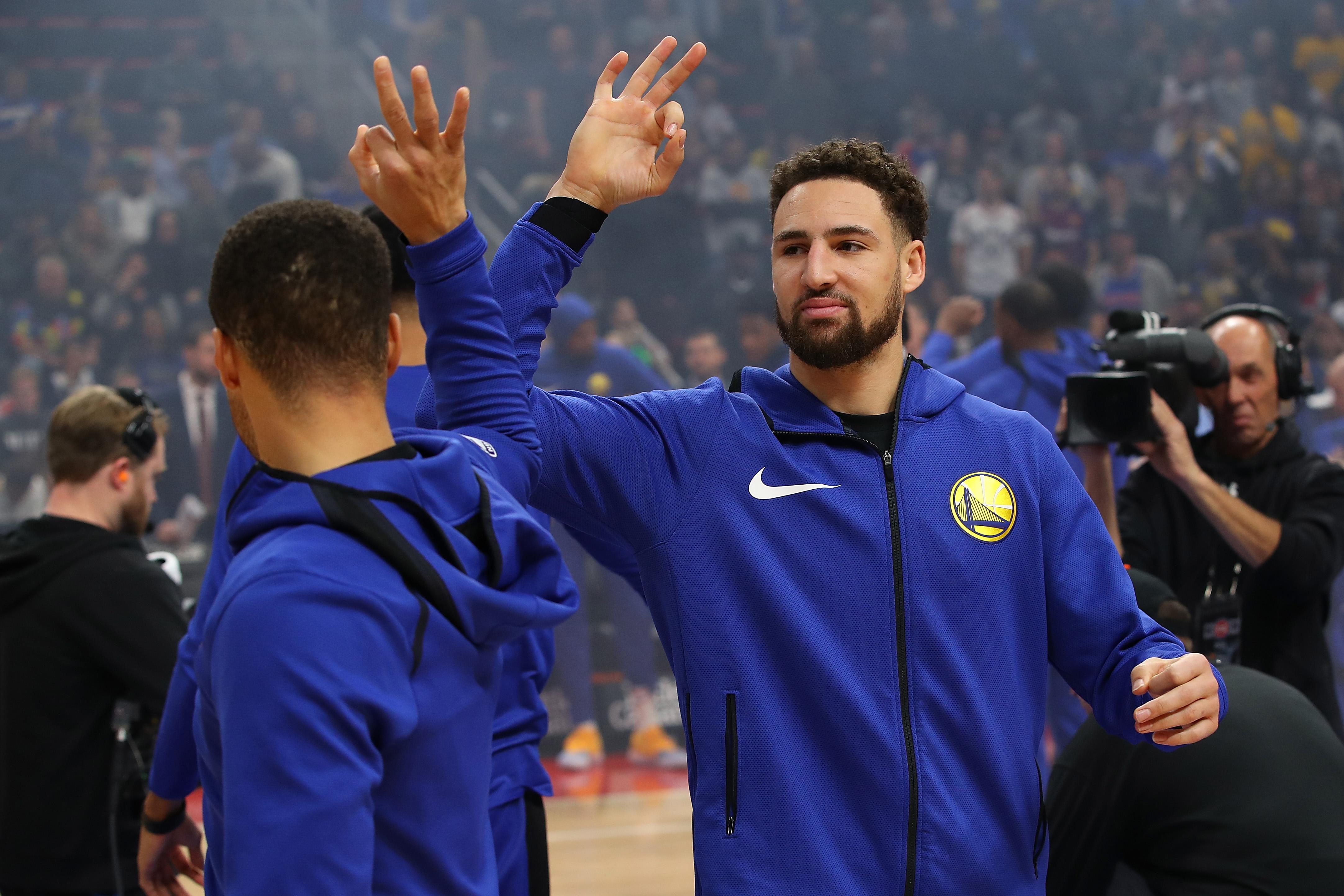 DETROIT, MICHIGAN - DECEMBER 01:  Klay Thompson #11 of the Golden State Warriors is introduced prior to playing the Detroit Pistons at Little Caesars Arena on December 01, 2018 in Detroit, Michigan. NOTE TO USER: User expressly acknowledges and agrees that, by downloading and or using this photograph, User is consenting to the terms and conditions of the Getty Images License Agreement. (Photo by Gregory Shamus/Getty Images)