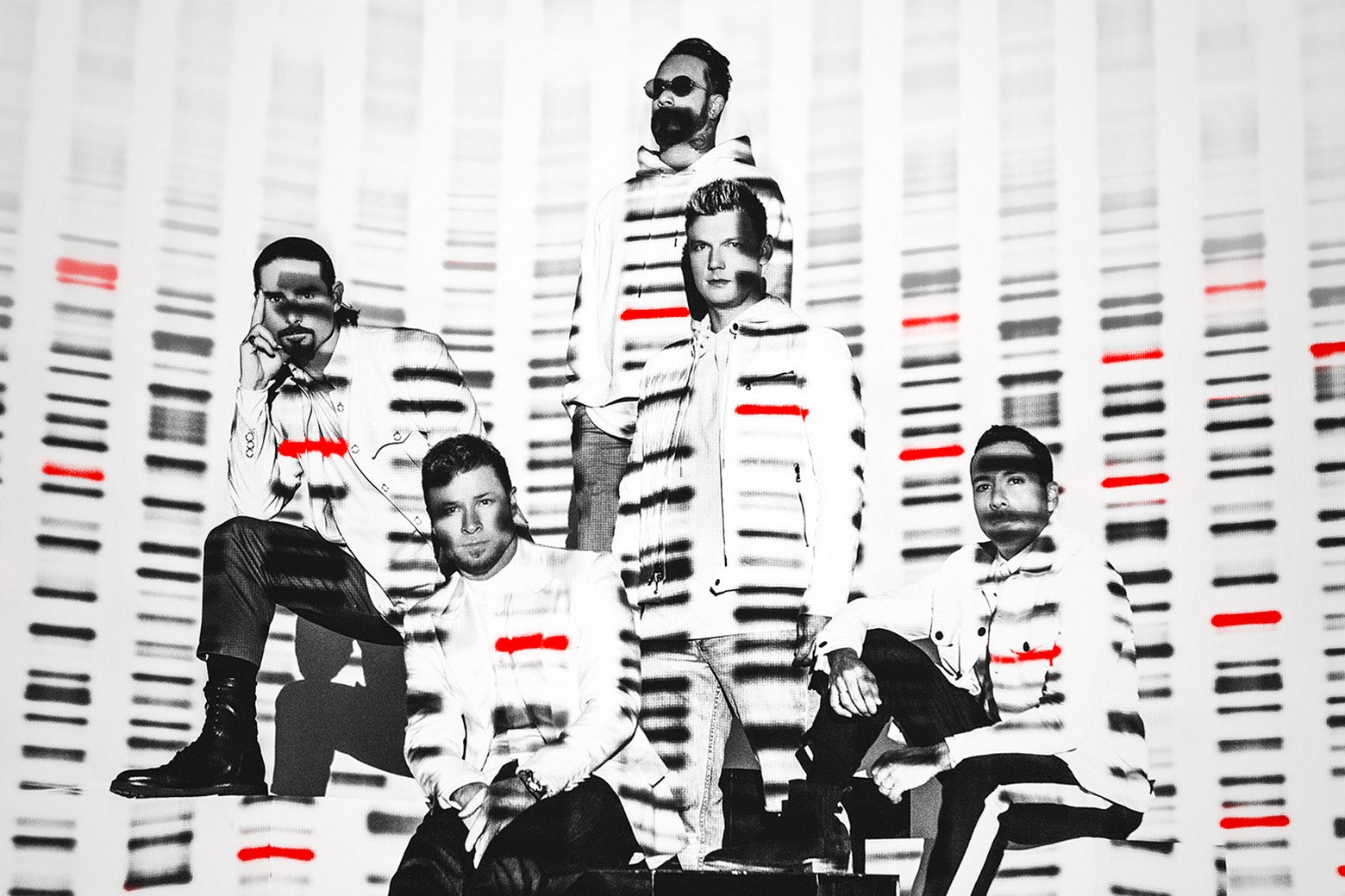 The Backstreet Boys posed, lit with red and black bands of color resembling a DNA sequencing image.