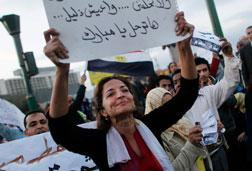 An Egyptian woman holds up a sign in Tahrir Square. Click image to expand.