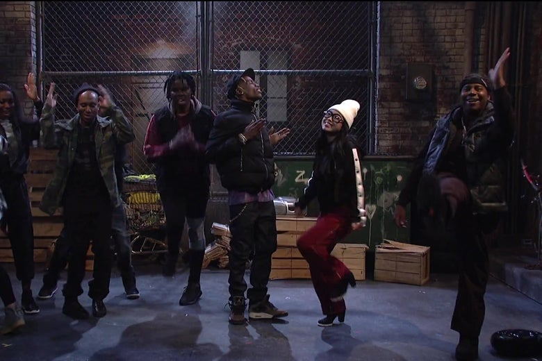Awkwafina, Travis Scott, and the Saturday Night Live cast dancing.