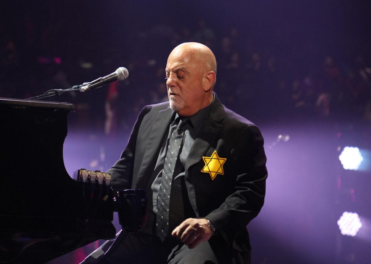 Billy Joel wears a jacket with the Star of David