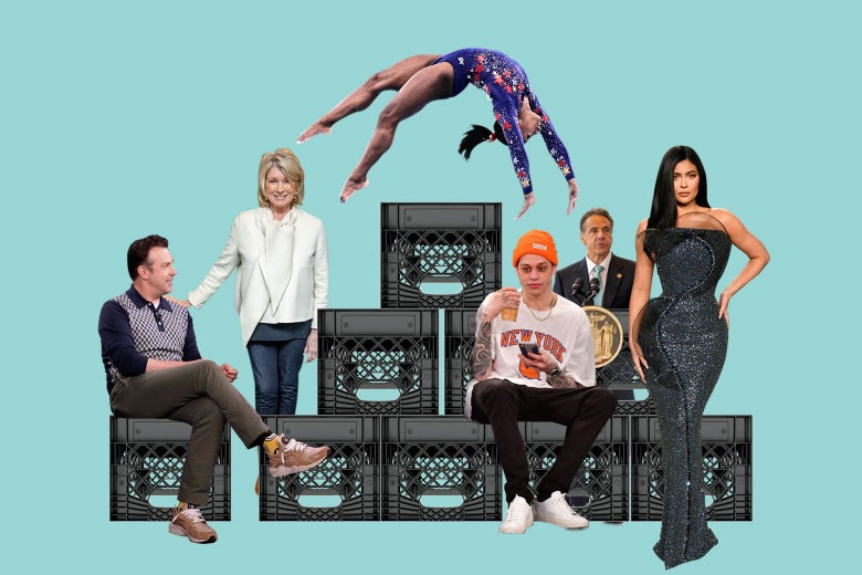 A stack of black milk crates surrounded by celebrities.