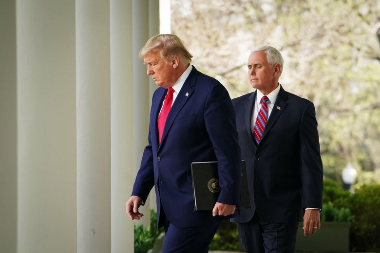 US President Donald Trump and Vice President Mike Pence make their way through the Colonnade for the daily briefing on the novel coronavirus, COVID-19, in the Rose Garden of the White House in Washington, DC, on March 30, 2020. (Photo by MANDEL NGAN / AFP) (Photo by MANDEL NGAN/AFP via Getty Images)