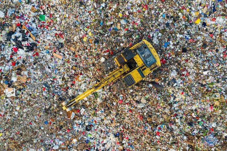 An overhead shot of a crane sorting through plastic waste