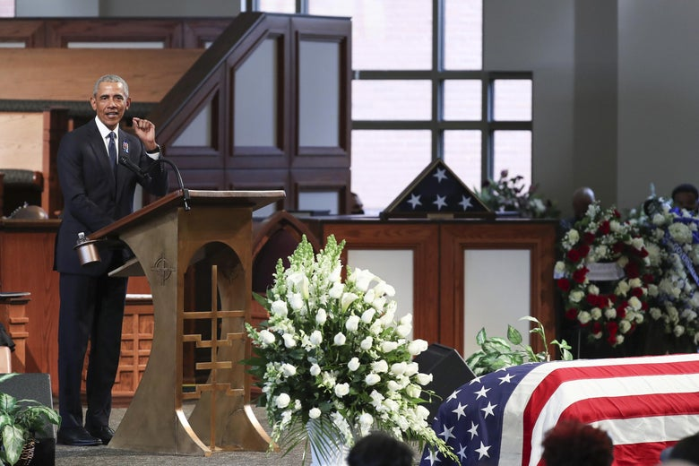 Obama stands at a podium with Lewis' American flag–draped casket just visible in the foreground.