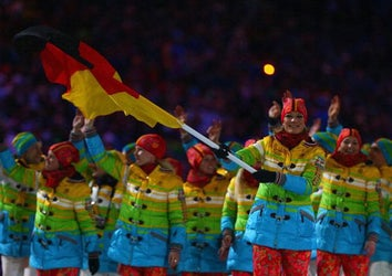 Skier Maria Hoefl-Riesch of the Germany Olympic team carries her country's flag during the Opening Ceremony of the Sochi 2014 Winter Olympics at Fisht Olympic Stadium on February 7, 2014 in Sochi, Russia.