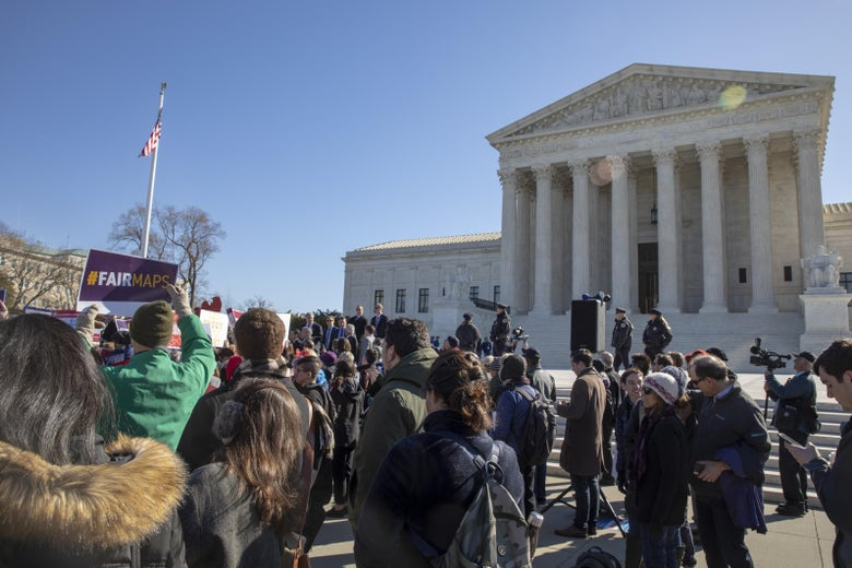 Protesters rally outside the Supreme Court.