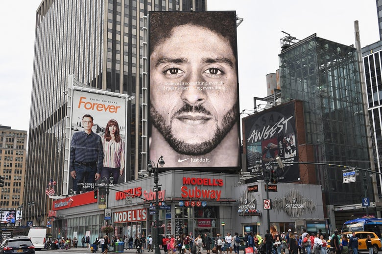 A Nike Ad showing Kaepernick's face stands above a New York City street corner.
