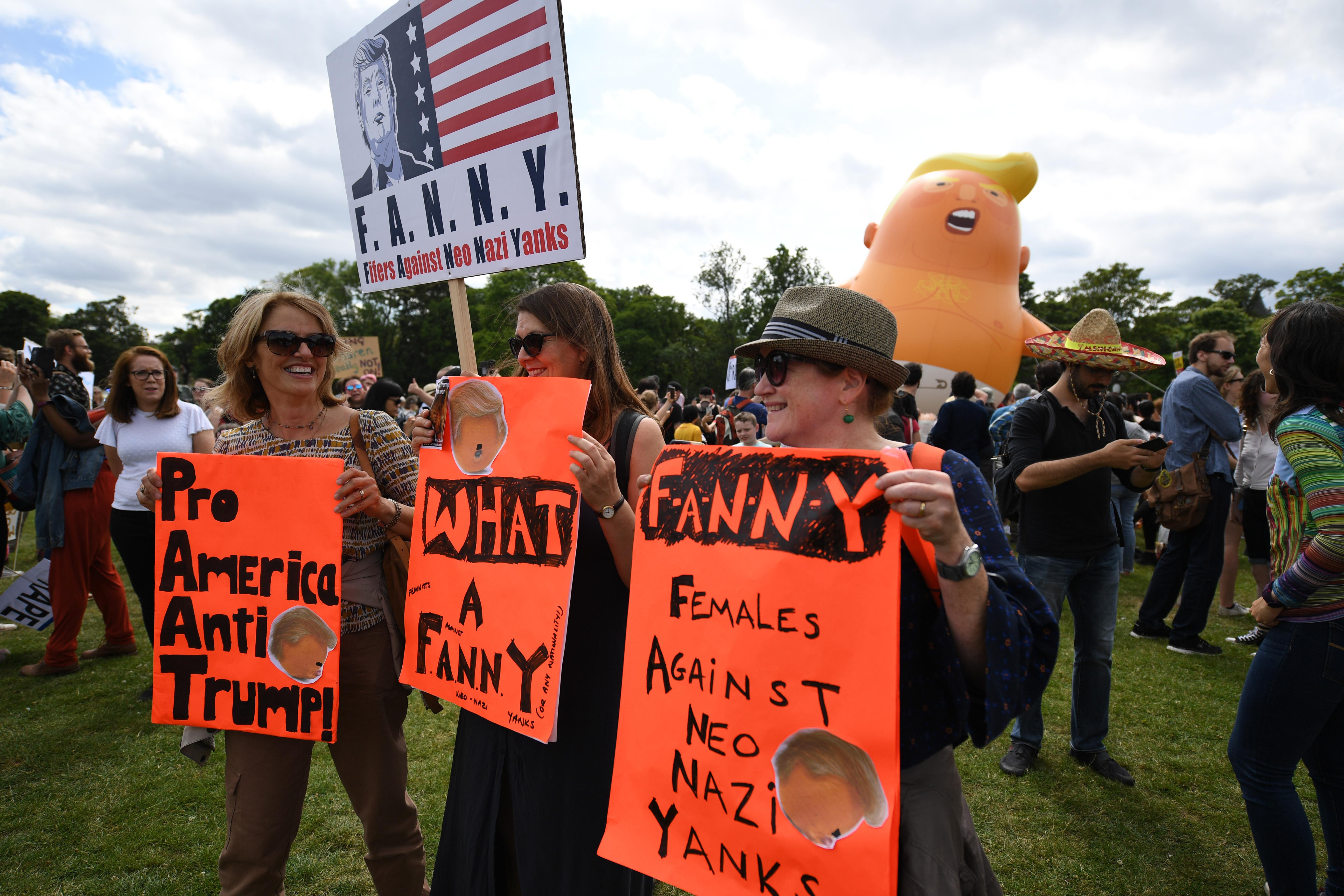 The Baby Trump Balloon floats in the middle of crowds holding anti-Trump signs while the U.S. President is visiting Trump Turnberry Luxury Collection Resort in Scotland as people gather to protest during his visit to the United Kingdom on July 14, 2018 in Edinburgh, Scotland.