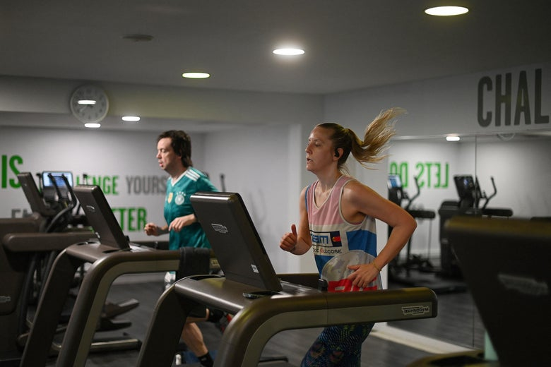People use the running machines as the indoor gym reopens at Clissold Leisure Centre in north London as coronavirus restrictions are eased across the country following England's third national lockdown, on April 12, 2021.